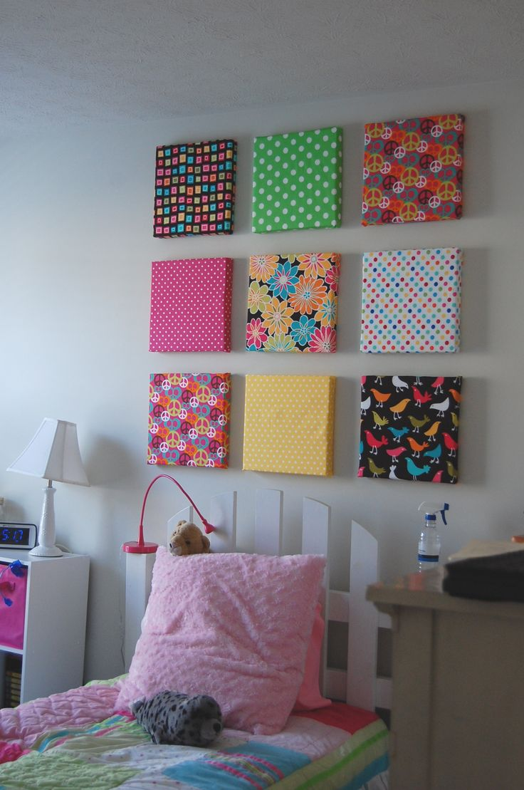 "Finally finished my daughter's room.      I bought styrofoam sheets @ Home Depot & cut them with knives in 12x12"" squares & doubled them up for dimension (gluing together with Elmer's Glue).    After glue was dry, I covered with fabric - tacking with hot glue (low temp) & straight pins. All are hung on 1 1/2"" brad nails punched straight into the styrofoam.  The leftover styrofoam will be covered & used as bulletin boards for our pantry, laundry & her bedroom…"