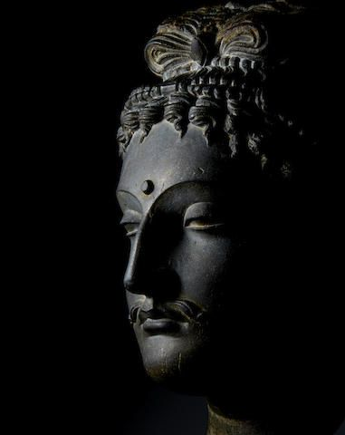 A schist head of a bodhisattva Ancient region of Gandhara, 3rd/4th century