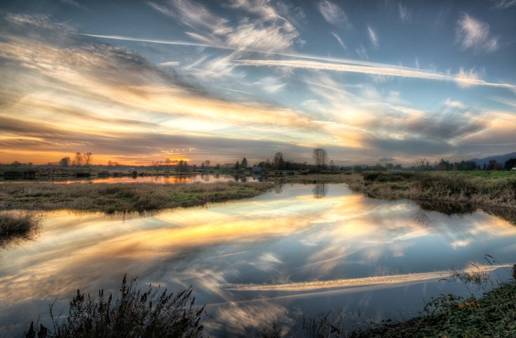 An impressive display of clouds at sunset on a beautiful November day.  Location: Trans Canada Trail, Pitt Meadows, British Columbia, Canada
