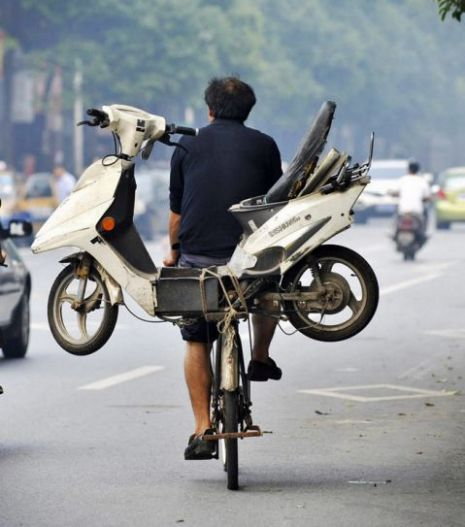 Drunk man takes scooter on a bike to get around drink-drive laws A man in China thought of a novel way to bypass local drink-drive laws after tying his scooter to the back of his bicycle in order to get home after a boozing session.
