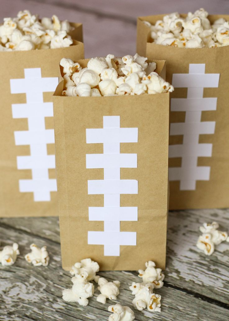 Make cute and simple Football Bags to hold your Homemade Butter Popcorn. They are easy to re-fill and can be used all Super Bowl Sunday long which limits the mess and cuts down the use of more paper goods. @countrycrock