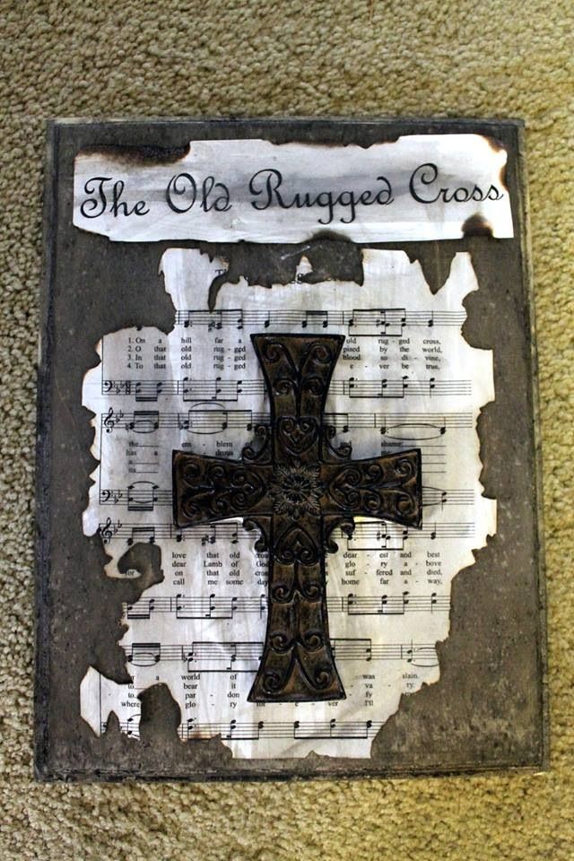 "Coffee, vinegar and steel wool stain on scrap unfinished wood with distressed sheet music of ""The Old Rugged Cross"" and a $3 cross from Hobby Lobby. #cross #woodstain"