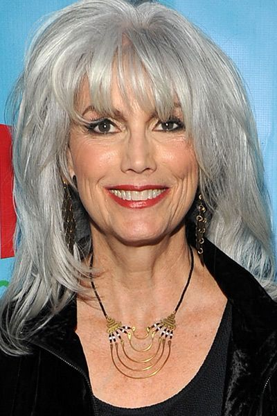 Emmylou Harris....boy does she rock that hair! I know my husband would love it if I did this, too. :) Maybe when I turn 50.