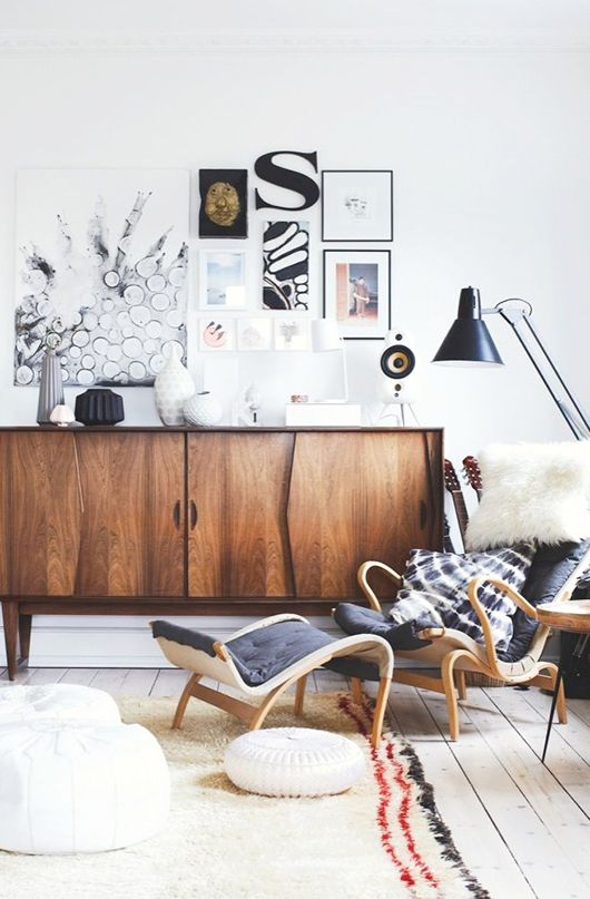 Danish modern living room with mixed art and wooden console.