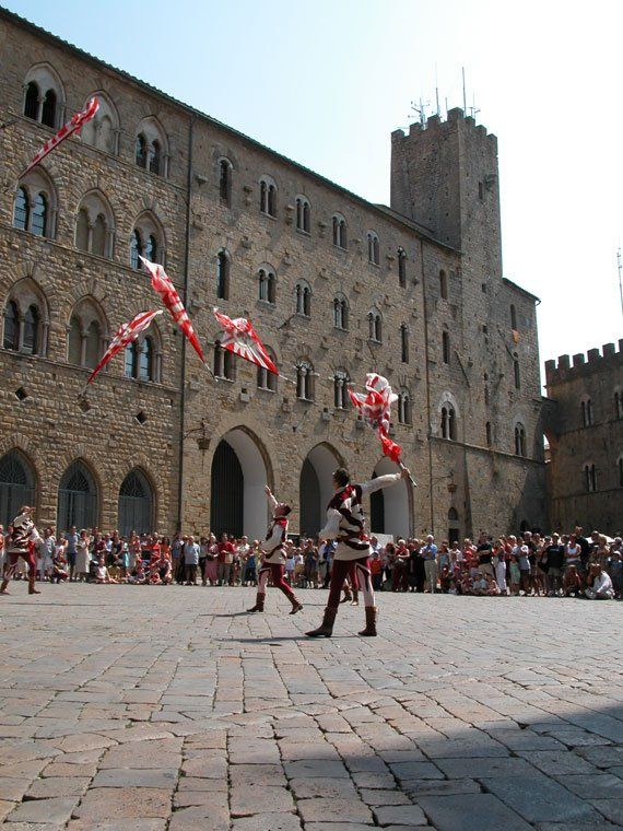 Flagthrowers put on a performance for visitors to the AD1398 medieval festival in Volterra.