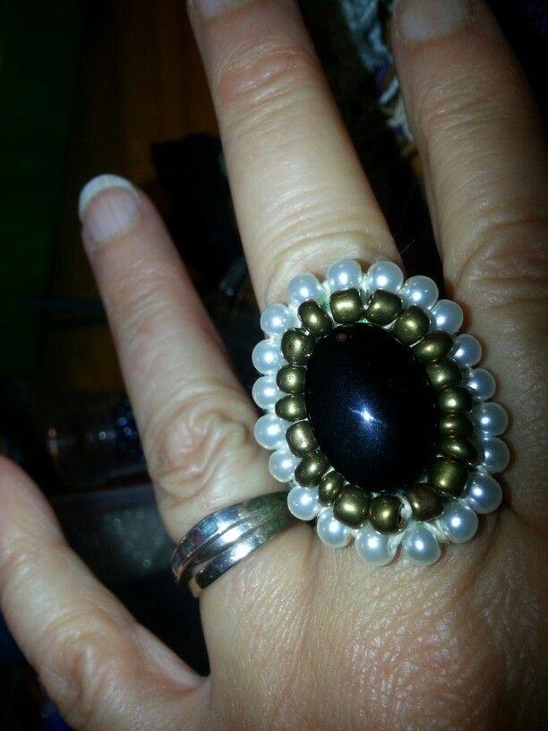 Black gold and white glass bead embellishment on crochet ring
