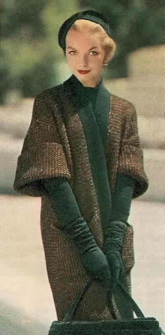 1950s sweater style outerwear fashion. Gloves, hat, coat, purse.