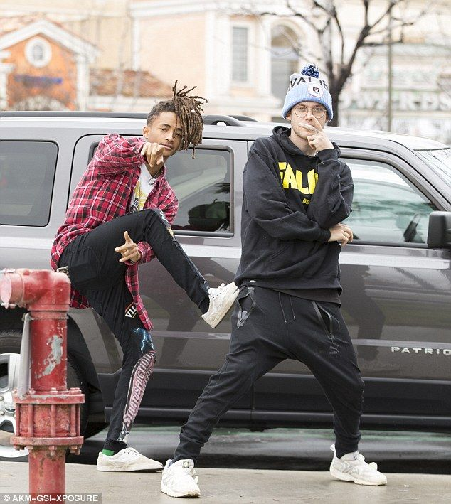 Having a laugh at the mall: Jaden Smith goofed around with his friend Harry Hudson outside...