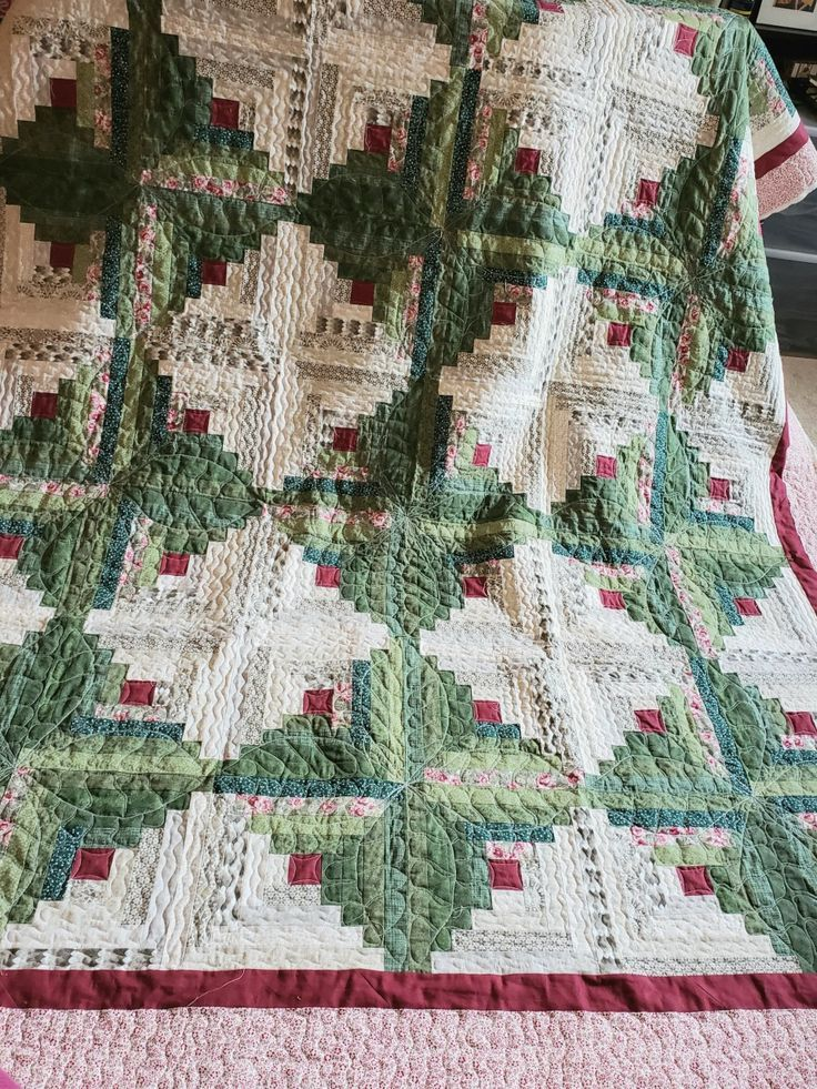 Making a Queen size scrappy log cabin quilt.