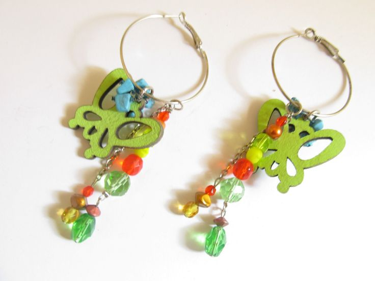 Handmade laser cut leather earrings (1 pair)  Made with light green leather butterflies, silver tone antiallergic earring hoops and glass beads.