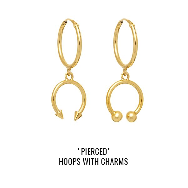 'Pierced' hoops with charms: a pair of sleeper hoops with asymmetric piercing-style charms featuring studs and balls.
