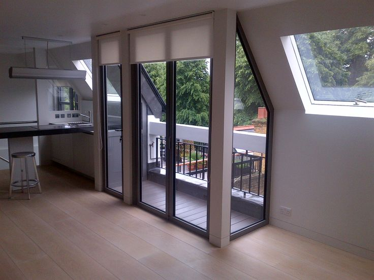 ODC glass and doors - Transforming a one-bedroom flat with the use of folding sliding doors onto a balcony area and roof lights to allow more light in. Urban living at its best...x