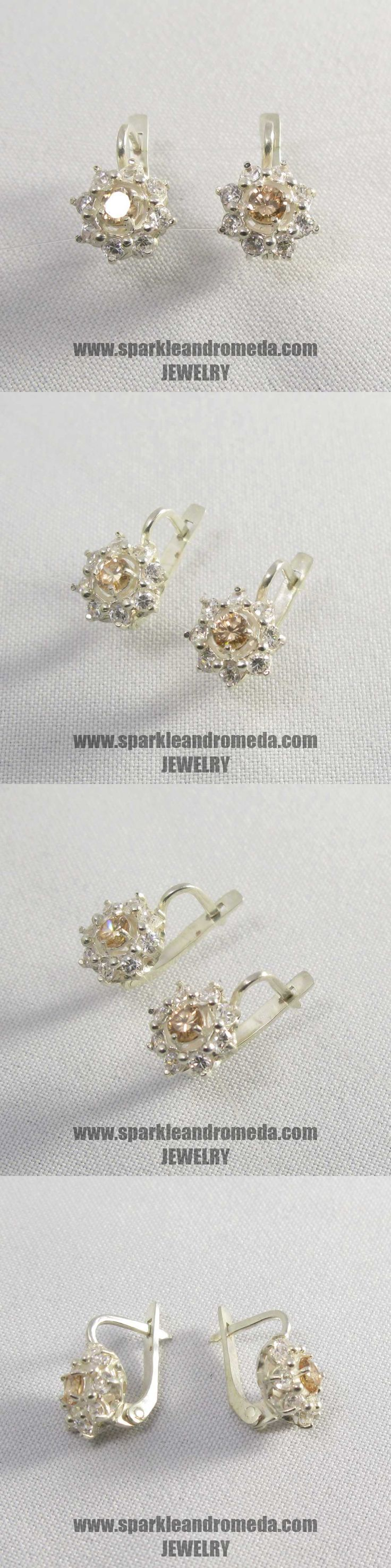 Sterling 925 silver earrings with 2 round 4 mm golden beryl color and 16 round 2,5 mm white color cubic zirconia gemstones.