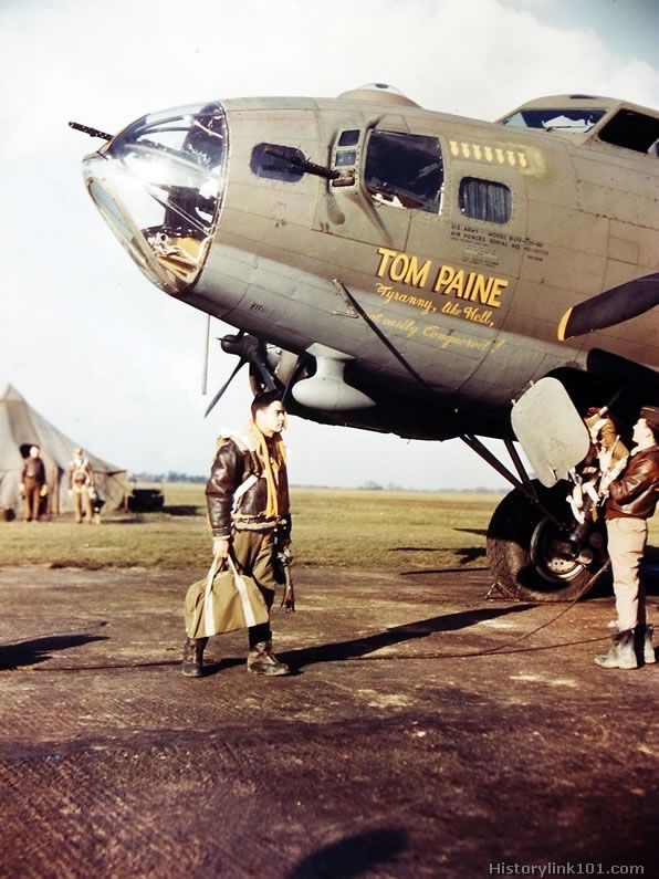 "Crew of B-17 Flying Fortress prepares for mission. When the men of an 8th Air Force group gave the town of Thetford, England, a plaque, honoring it as the birthplaces of Thomas Paine, American patriot philosopher and author, the crew of a B-17 thought it appropriate to name their plane ""Tom Paine"" and to inscribe the fuselage with one of his famous remarks, ""Tyrrany, like hell, is not easily conquered."""