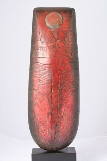 Red Totem with copper patina disc inset, by Peter Hayes