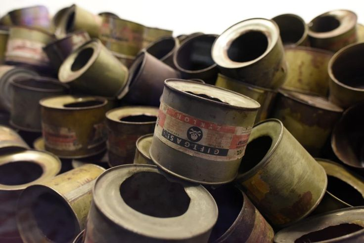 Ghosts of Auschwitz - Empty Zyklon B canisters displayed at Auschwitz concentration and extermination camp