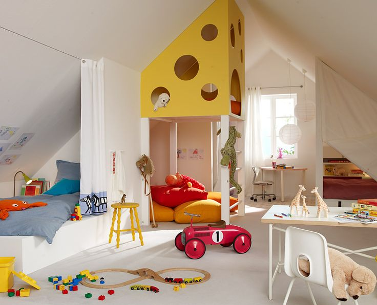 Bedroom, playroom and study all in one! Nice idea to use curtains to provide some privacy & coziness at bedtime!