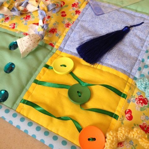 See if can find some big buttons that would slide on a ribbon? Sharky Knows: Creative Corner: Fidget Quilts