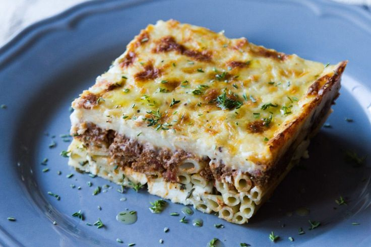Pastitsio baked pasta casserole by chef Akis. A delicious pastitsio baked pasta recipe with zitti pasta, ground meat, a creamy bechamel sauce, gruyere and feta cheese.