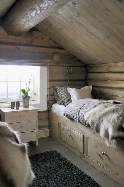 Such a great use of space for an attic or loft.  Bed built into/next to wall with storage space underneath!  Genius!