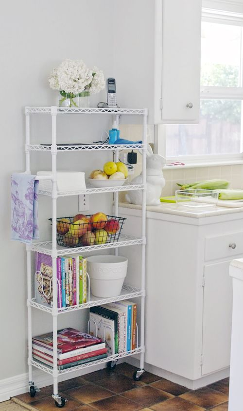 The shelf dividers used to keep the cookbooks upright on the wire shelving unit look similar to some of the pan/lid dividers I have seen, which would be a great idea for kitchen organization for those of us who have wire shelving that didn't come with shelf dividers.