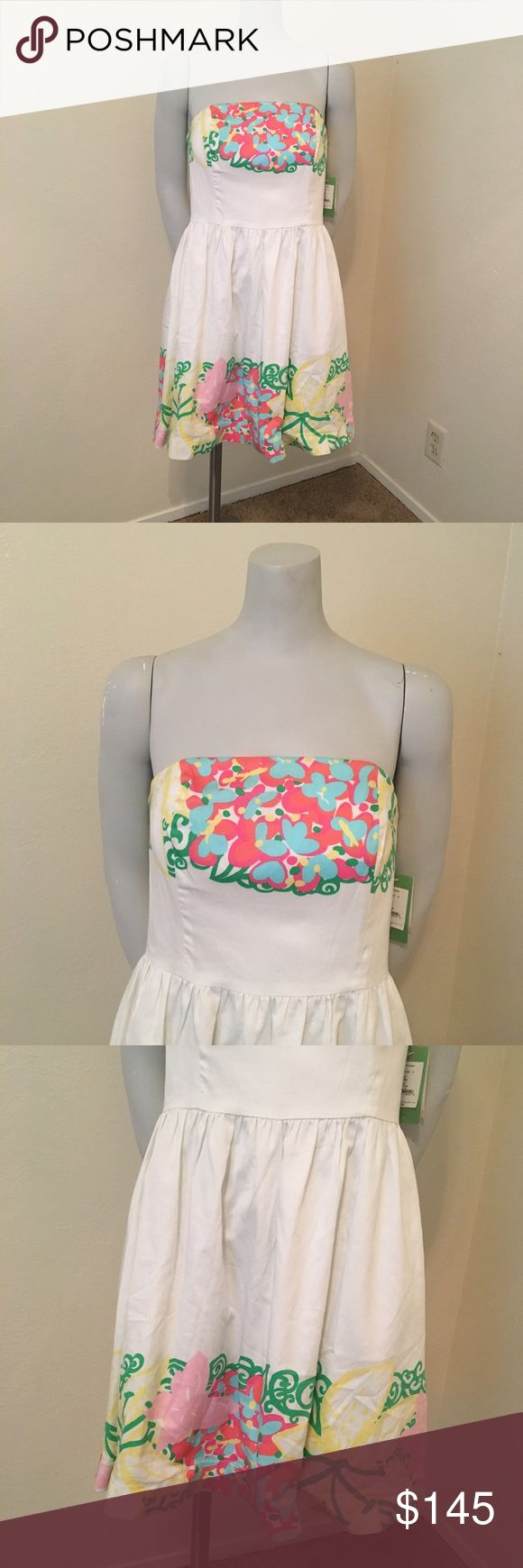 """NWT Lilly Pulitzer Lottie Dress in Mariposa Placed Item: Lilly Pulitzer """"Lottie"""" Dress   - Size: 6  - Material: 100% cotton - Condition: NWT  - Color: Resort White Mariposa Placed - Pockets:  - Lined: yes - Style: Lottie  *Measurements:  Bust: 15"""" Waist: 14.5"""" Length: approx 29""""    * Almost all my prices are negotiable and no offer offends me! * Lilly Pulitzer Dresses Strapless"""