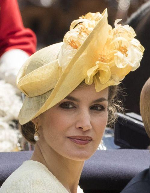 María Nieto yellow flower hat