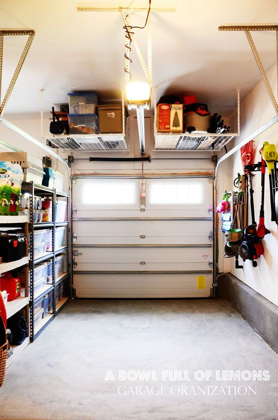 Love this tuck-up-and-away shelving in the garage to keep things off the floor. Perfect for seasonal storage or seldom used items. Via A Bowl Full of Lemons
