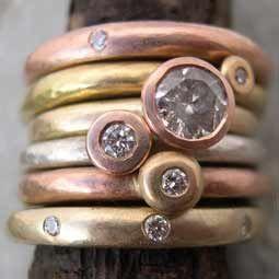 Stack of handmade diamond engagement rings