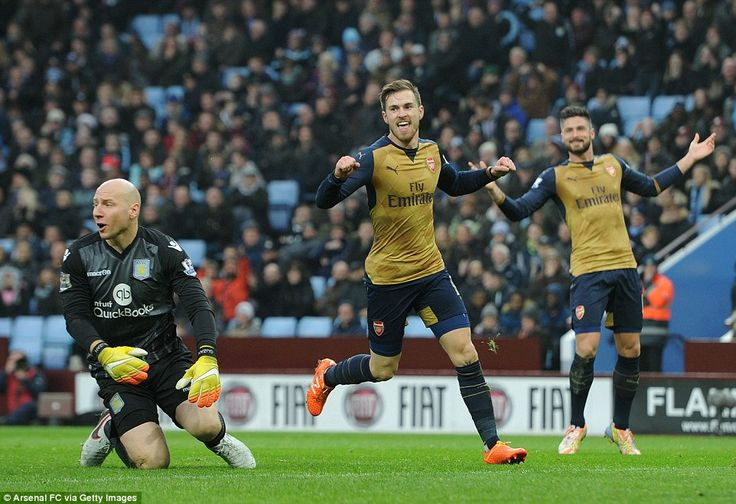 Aaron Ramsey (centre) celebrates after starting and finishing a stellar counter attack for Arsenal's second goal against Aston Villa