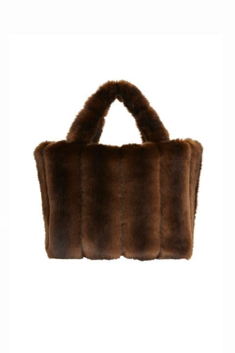 The Staud Fur Tote Bag has a classic silhouette and comes in a rich deep chocolate color.