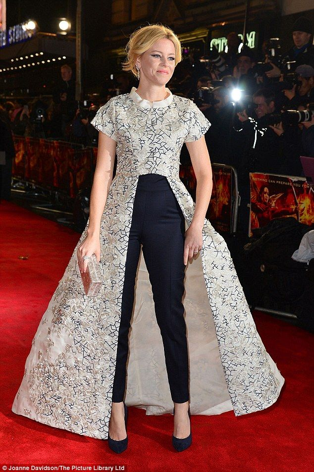 High glamour: Elizabeth Banks tried an Emma Watson look with a long skirt over trousers...
