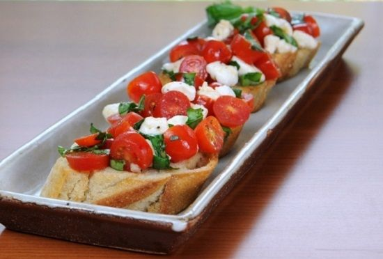 Bruschette Carrabba garlic-flavored bread topped with Italian cheeses, mushrooms and tomatoes. Ingredients: 1 loaf Italian or French bread 1 stick butter,