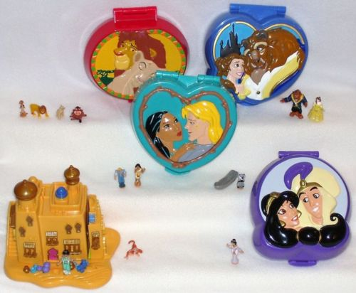 AH! I was so into Polly Pockets and Disney when I was a kid...how in the HELL did I not know about these!!!