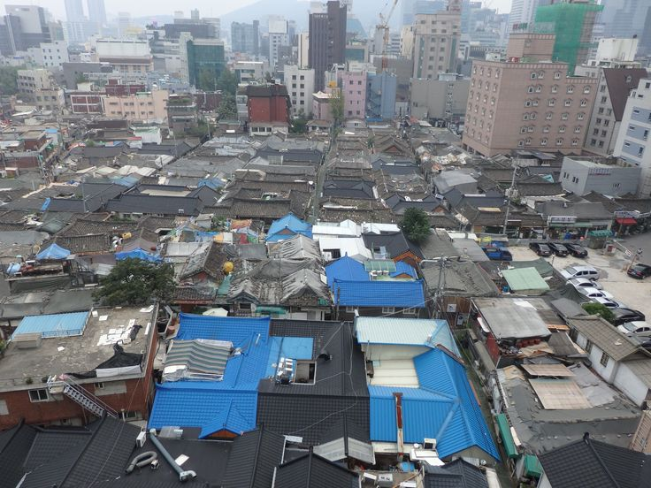 a neighborhood of hanok houses and the city encroaching on it in Seoul, South Korea