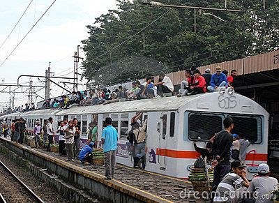 Jakarta, Indonesia, 18 February 2012 - People ride on the roof of a commuter train in Jakarta.