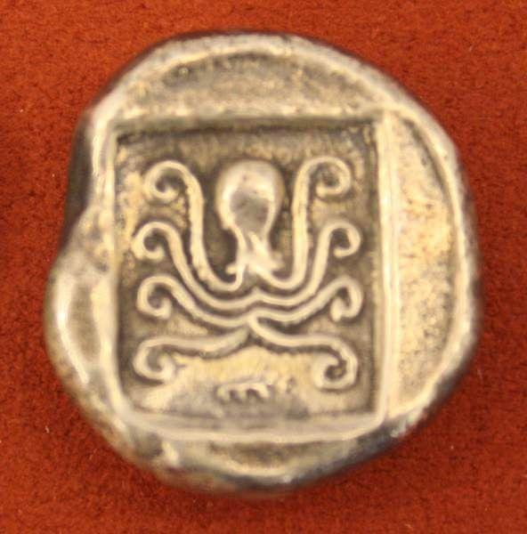 Silver tetradrachm from Eretria Euboea, c. 485 BCE. O: Cow, R: Octopus in incuse square. (Alpha Bank Numismatics Collection, Kerkyra, Corfu)