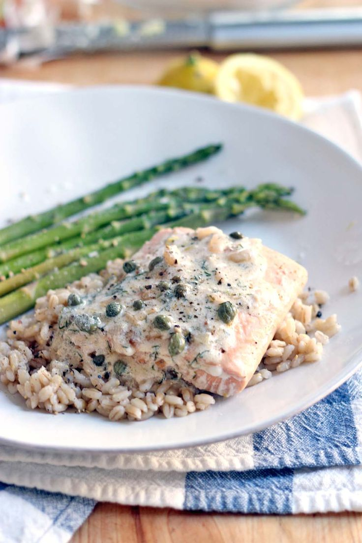 Garlic Poached Salmon with Creamy Lemon Caper Sauce------sauce for fish with white wine, lemon, garlic, herbs, capers and Greek yogurt for creaminess.