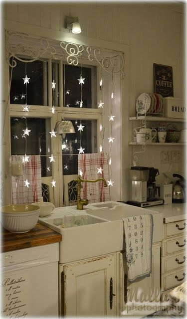 Star lights in the kitchen window