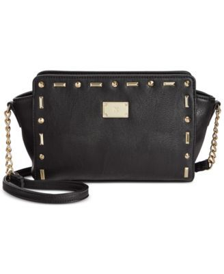 INC International Concepts Tifaany Mini Crossbody, Only at Macy's $23.99 INC International Concepts' mini crossbody bag makes a statement with golden accents and a modern go-anywhere shape.