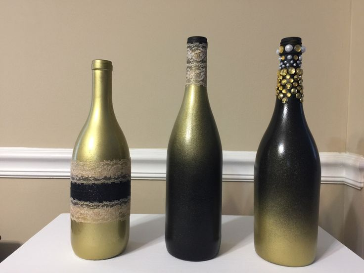Black and Gold shimmery wine bottle decor by TheVinoDoc on Etsy https://www.etsy.com/listing/506658795/black-and-gold-shimmery-wine-bottle