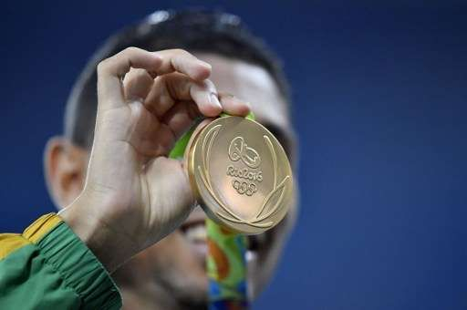 South Africa's Wayde van Niekerk holds his gold medal during the podium ceremony…