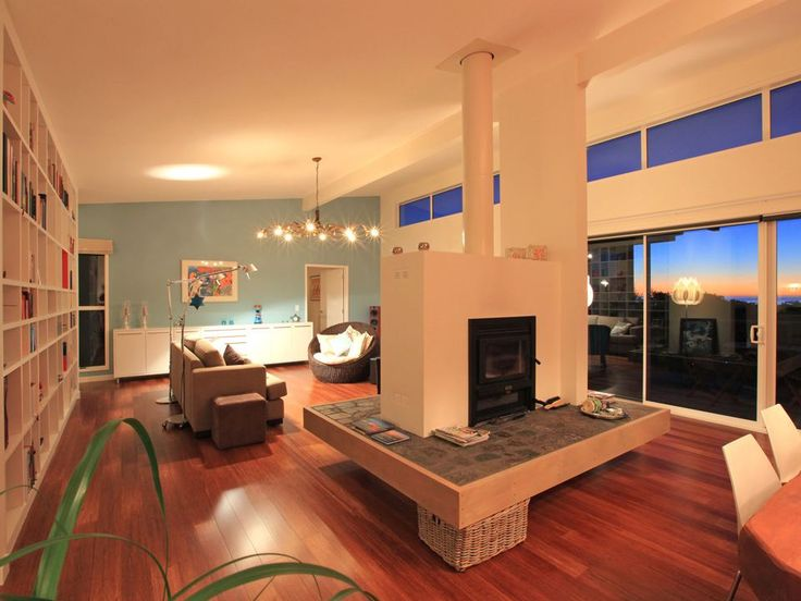 2010 Silver Award Winning Renovation   living featuring double-opening central fireplace