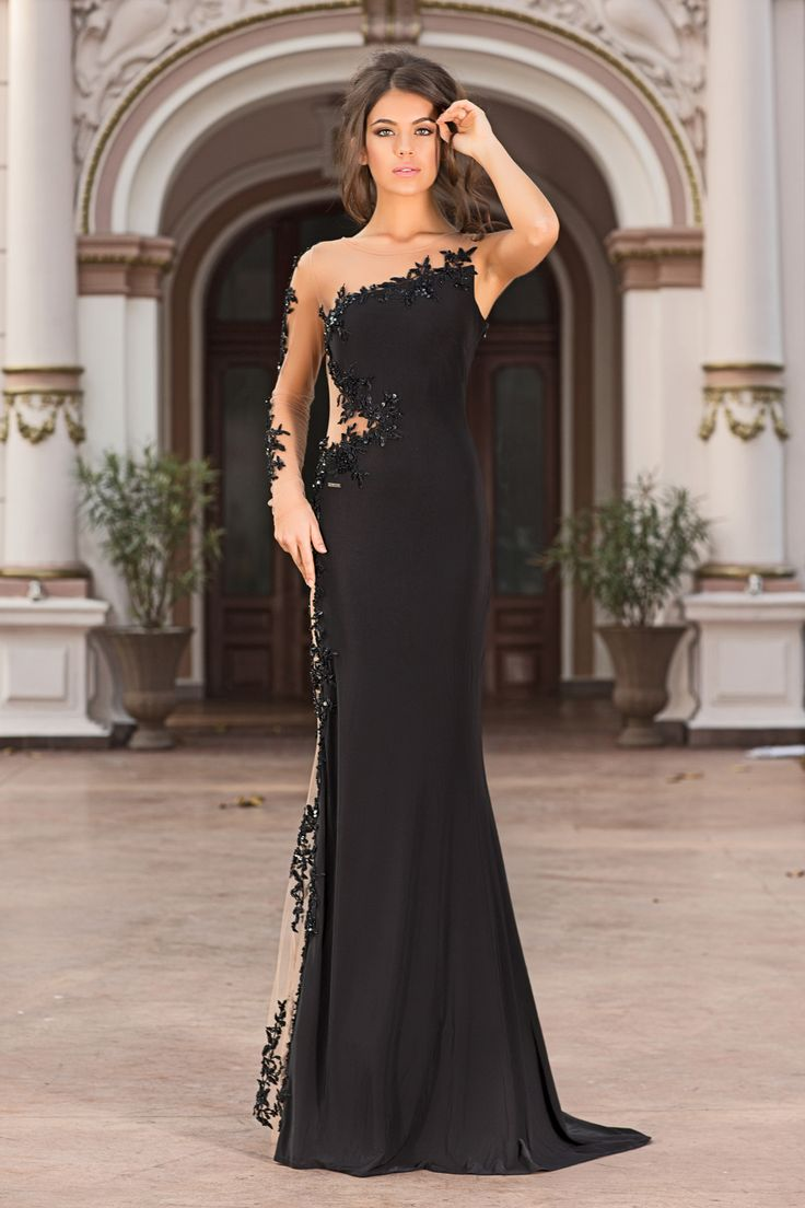 A divine in this long black sumptuous evening dress.The transparent side make your waist look slimmer and your legs look longer. The luxurious embroidery and decorative sequins complete the gown of your dreams.
