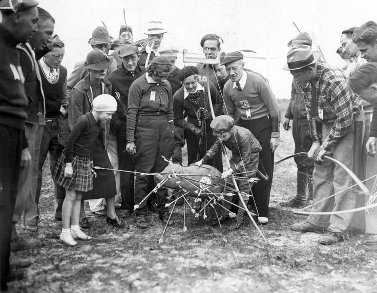 """They had an archery tournament at Atsion Lake  in October 1937 and here young Mickey Murray tries to find his arrow in the """"unique target."""""""