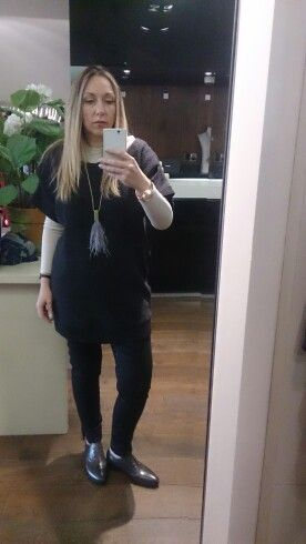 cos jumper, black jeans, grey brogues, feather necklace