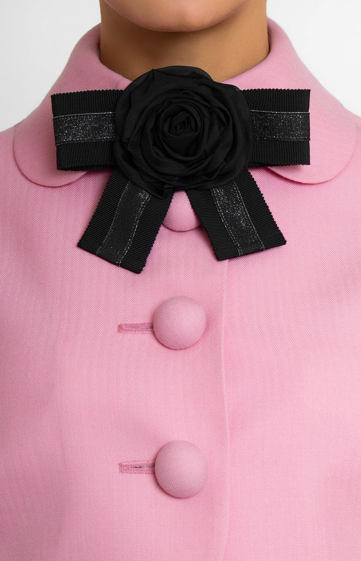 Genuine wool suit. Short jacket with turndown collar on stand. Tucked sleeves. Bow decorated with designer handmade rose. Half circle skirt with side seam pockets and hidden back zip closure.