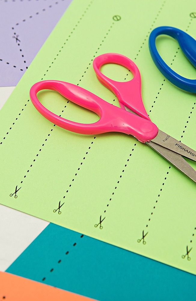 Teaching a little one cutting as they develop their fine motor skills? Turn it into an art project! Children will love our printable name tag project. Template included.
