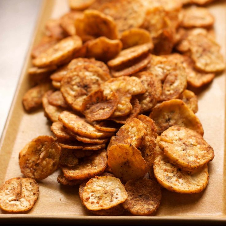 We all love banana chips but people who are health conscious they avoid eating them because they are deep fried. But here is a delicious and a no fried recipe with Baked Banana Chips Recipe.This recipe is easy to make and tastes great. These can also be packed in the snack box for kids. Serve Baked Banana Chips Recipe along with Tomato and Sunflower Seed Dip Recipe or Coconut & Ricotta Dip with Banana Chips Recipe during tea time for snacking along with a Smoothie or Masala Chai Recipe.  If…