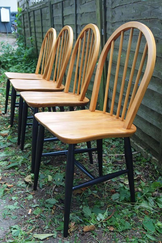 Set of four classic original Ercol dining chairs, with amodern twist, Model 400 Simple dignified and refined, superbly made and finished, useful anywhere in the house. Beech Legs and Elm seats. These chairs have been professionally stripped back, french polished and waxed, the legs